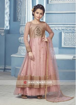 Peach Anarkali with matching Salwar and net dupatta.