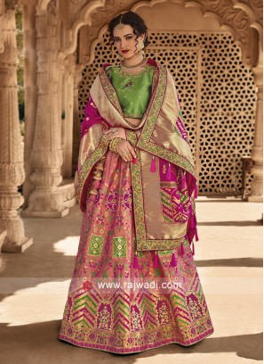 Peach and pink lehenga with pista green choli