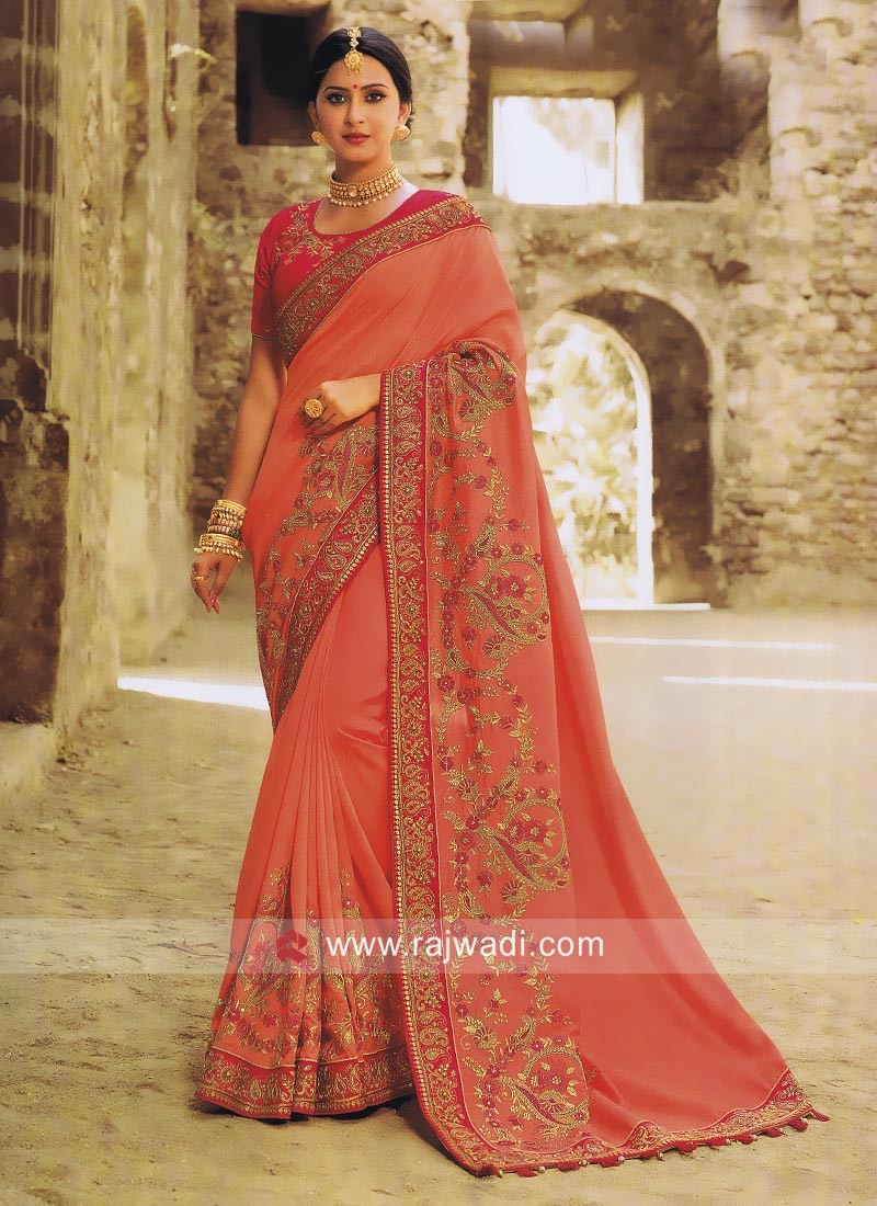 Peach Heavy Saree with Pink Blouse
