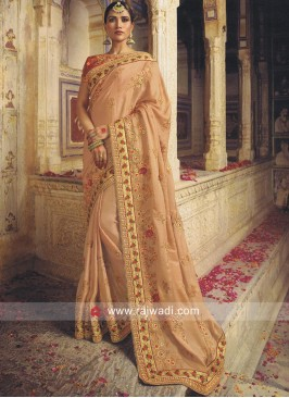 Peach Heavy Sari with Red Blouse