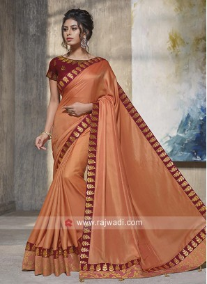 Peach Saree with Maroon Blouse