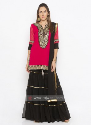 pink and black color garara suit