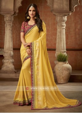 Pink And Yellow Jacquard Silk Saree
