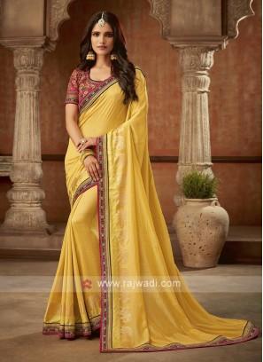 Pink And Yellow Jacquard Silk Saree