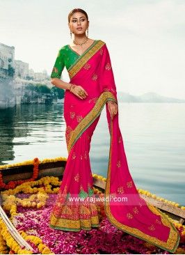 Pink color Art silk saree with contrast blouse.