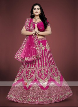 Pink lehenga choli with matching dupatta.