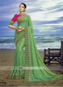 Pista Green banasari chiffon silk saree with contrast blouse.