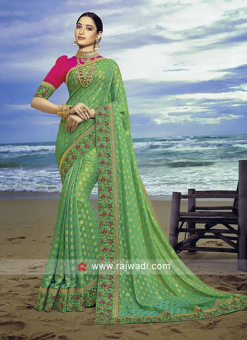 Pista Green banasari chiffon silk saree with contrast blouse.