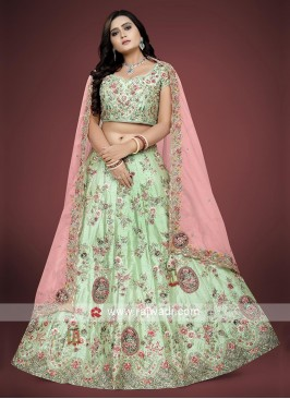 Pista green choli suit with net dupatta.