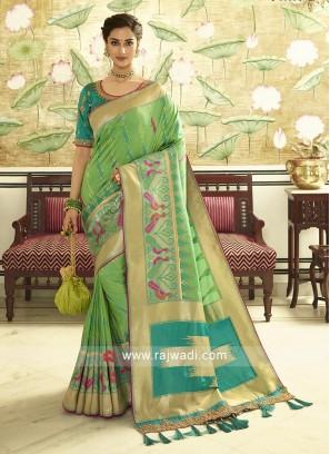 Pista Green color banasari silk saree with golden border.