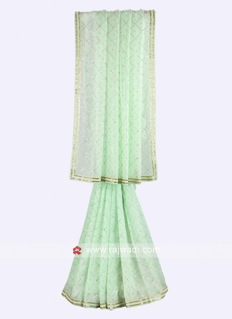 Pista green color tissue silk saree