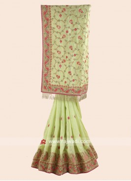 Pista Green Embroidered Saree with Pink Blouse