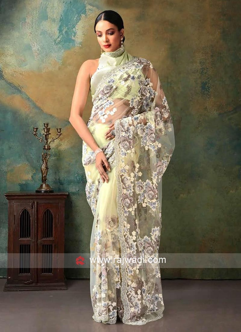 pista green fancy net saree