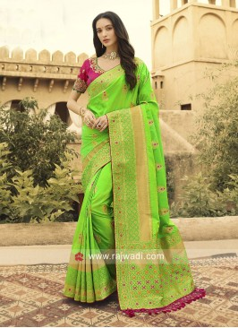 Pista Green Heavy Saree with Pink Blouse