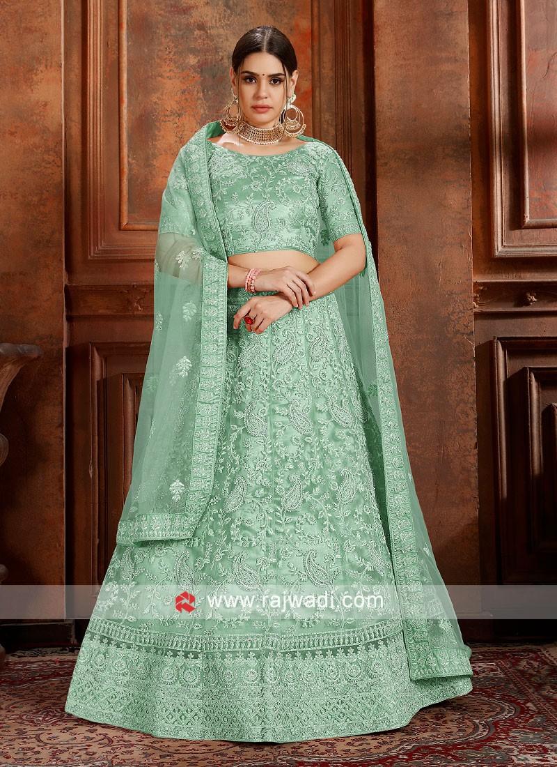 Pista Green soft net Lengha Choli with matching dupatta.