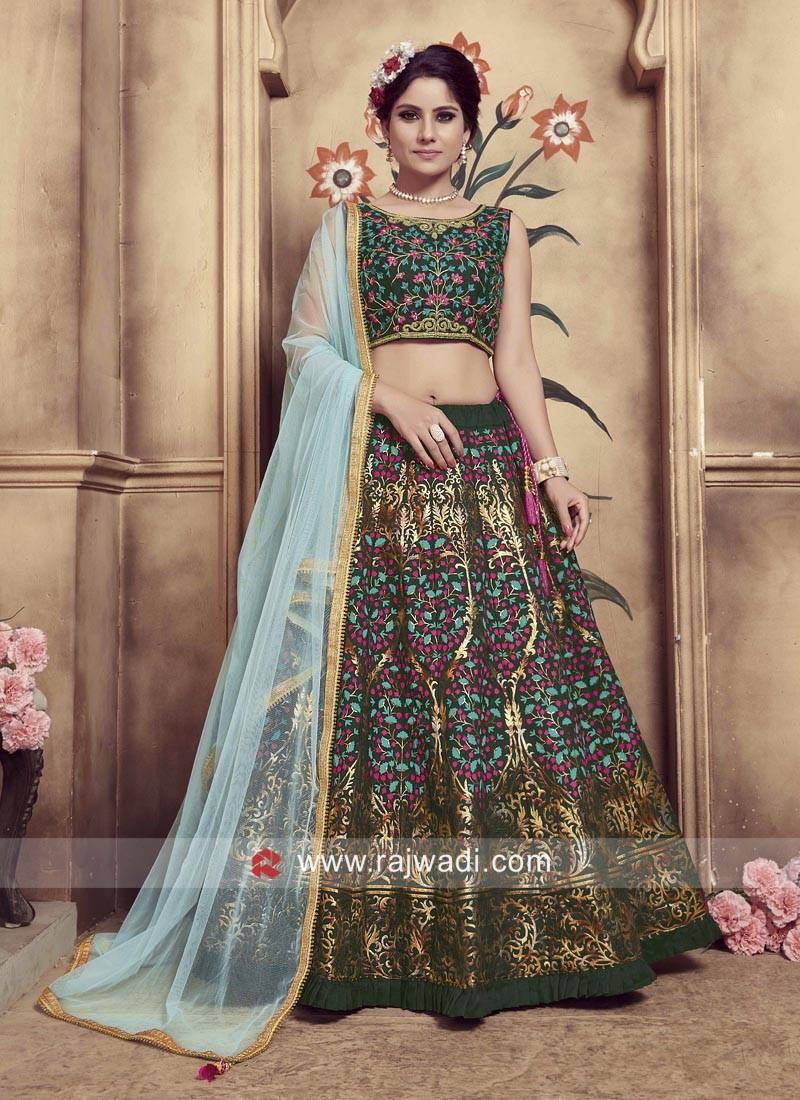 Pleasant Dark Green Heavy Embroidered Lehenga Choli