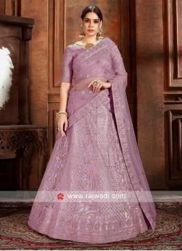 Purple Soft net lehenga Choli with matching dupatta.