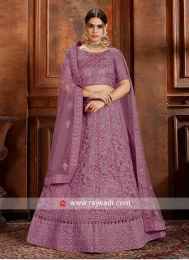 Purple Soft net lehenga Choli with matching dupatta.