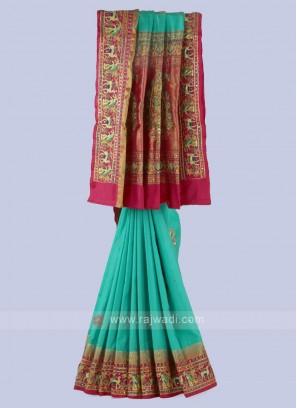 Rama Green And Rani Silk Saree.