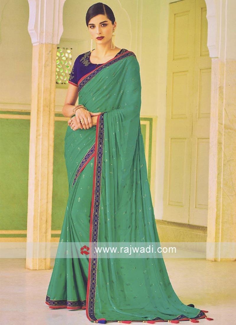 Rama Green Saree with Blue blouse