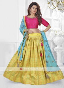 rani and yellow lehenga choli