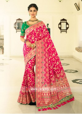 Rani color banasari slik saree with zari work unstiched contrast blouse