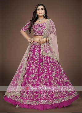 Rani color choli suit with contrast dupatta.
