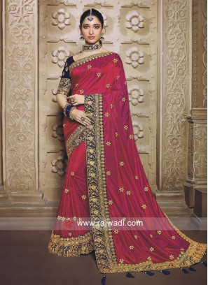 Rani Pink color saree with dark blue blouse