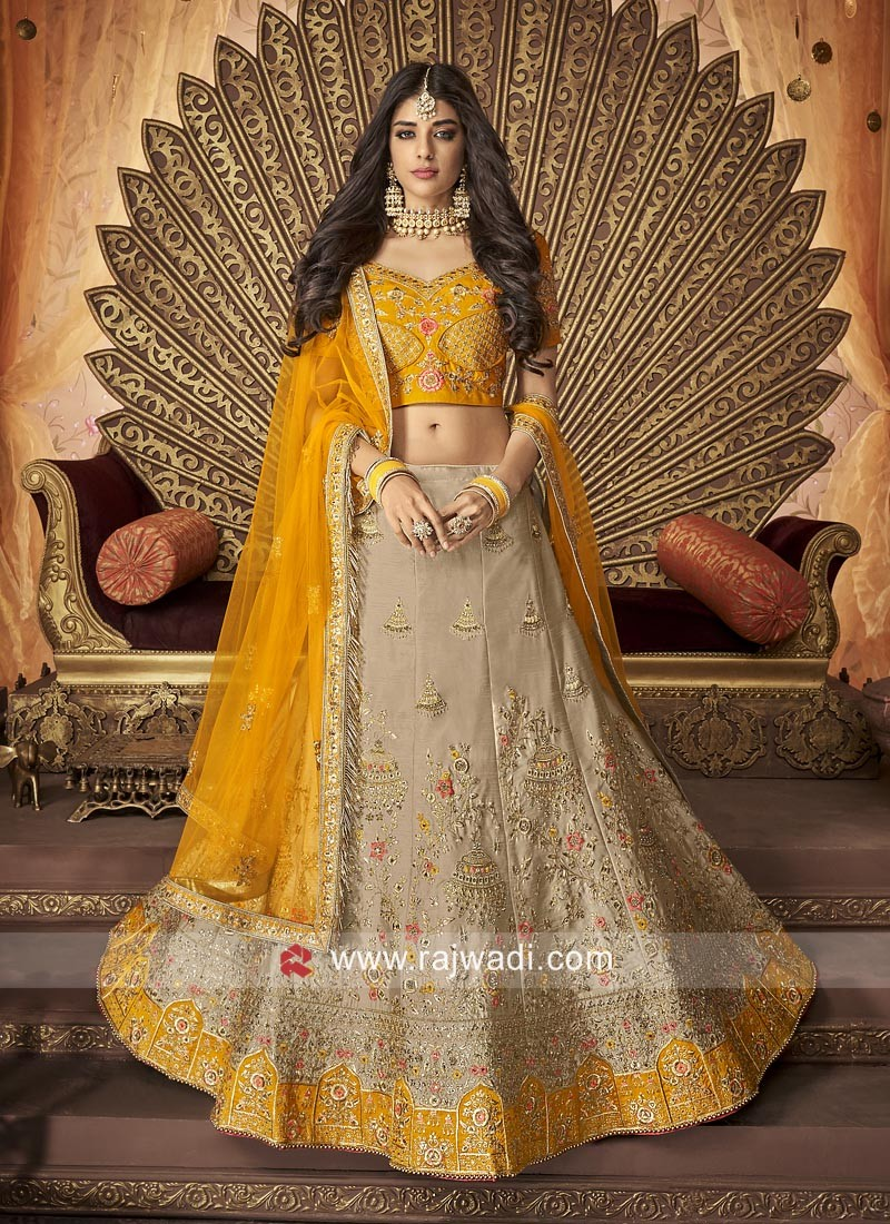 97748d0c1a4a79 Raw Silk Lehenga Choli with Net Dupatta. Hover to zoom