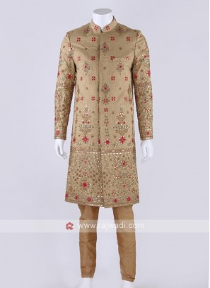 Raw silk sherwani in golden color