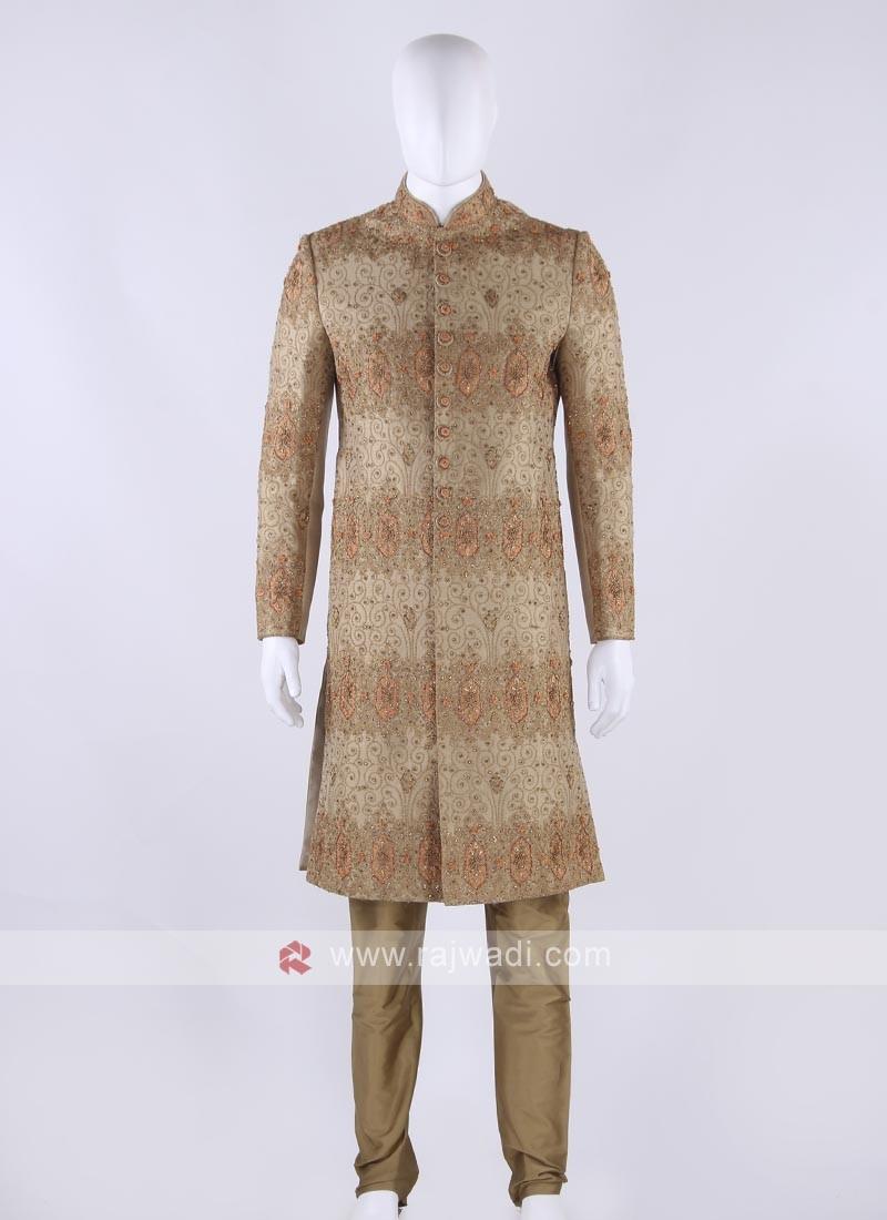 Raw silk sherwani in golden color