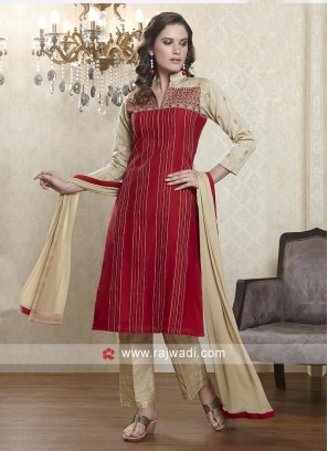 Red and skin salwar suit
