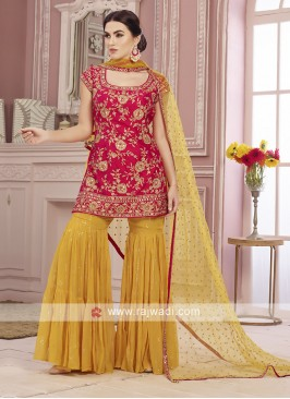 Red and yellow gharara suit.