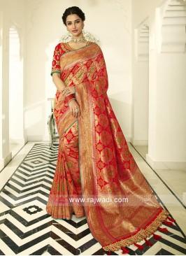 Red banasari silk saree with matching blouse with beautiful zari work.