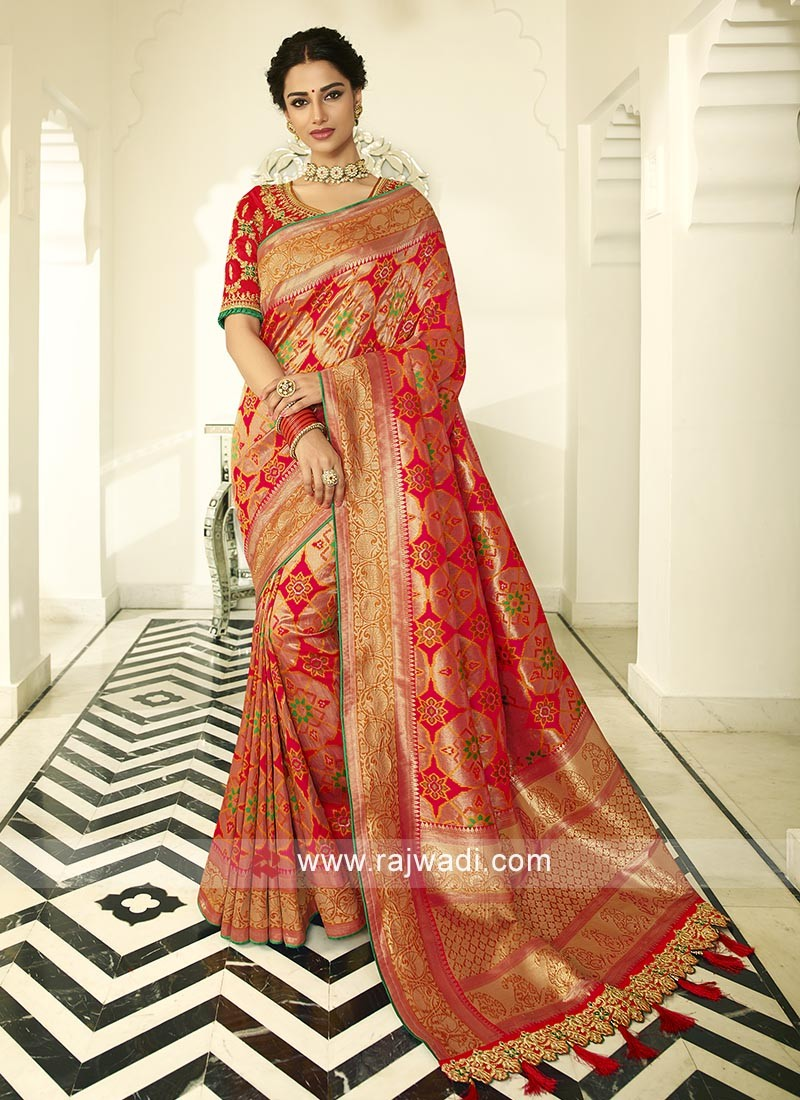 Red banasari silk saree with matching blouse with beautiful zari work.