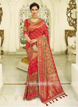 Red banasari silk saree with matching blouse with  zari work.