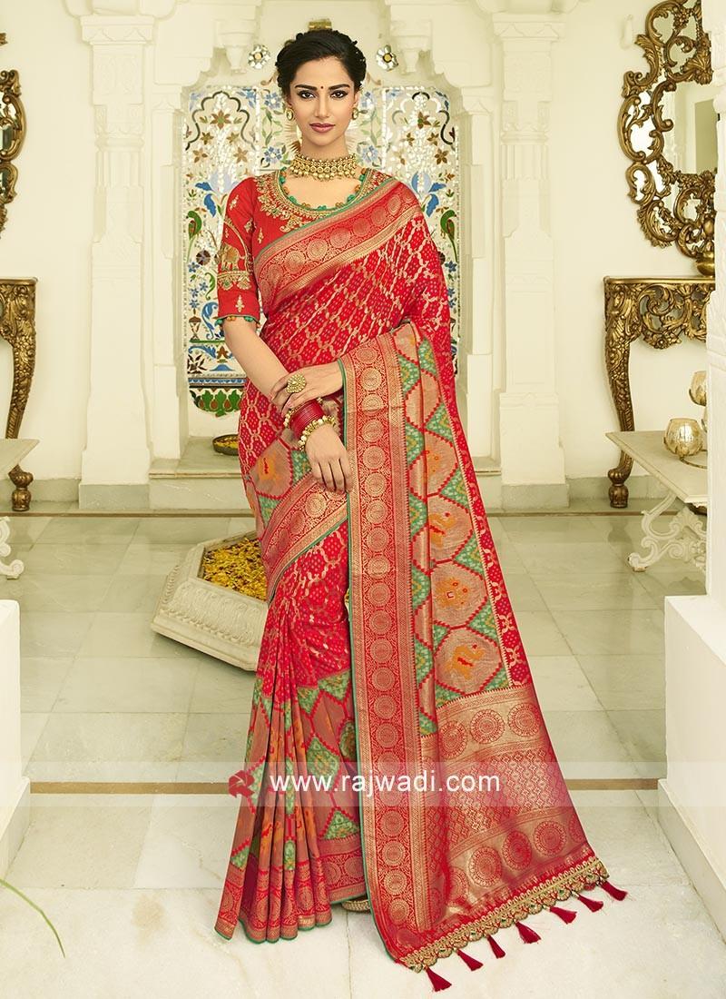 Red banasari silk saree with matching blouse with  zari work.