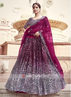 Attractive Wine Color Net Lehenga Choli