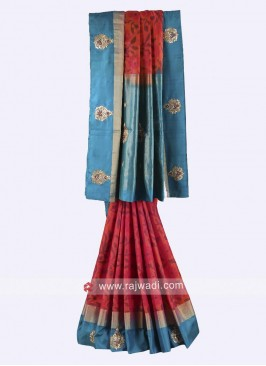 Rust and peacock blue color pure silk saree