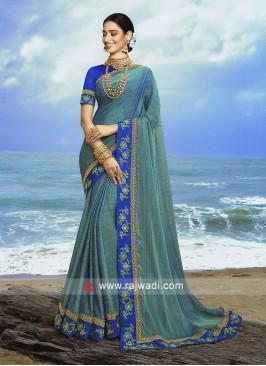 Sea Green  jacquard chiffon saree with blue blouse.