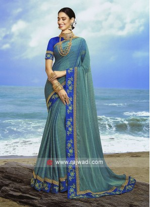 Sea Green  jacquard chiffon saree with blue blouse.