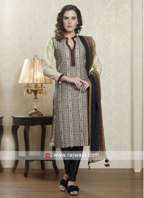 Skin and black salwar suit with dupatta