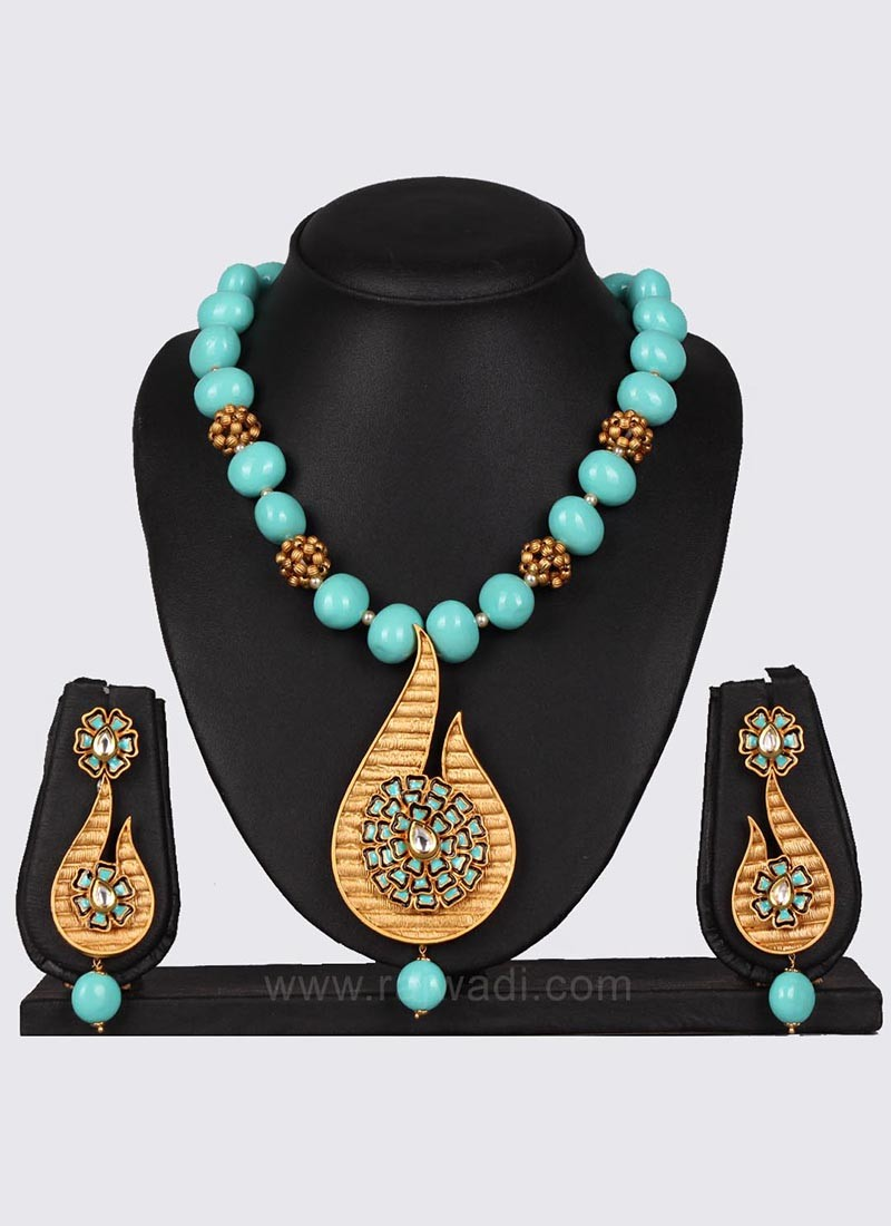 7a0c8e7bf Sky Blue and Golden Pearl Necklace Set