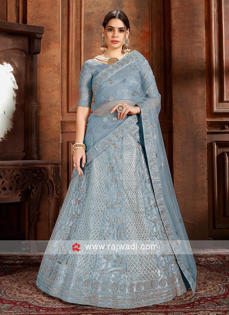 Sky Blue soft net Lehenga choli with matching Dupatta.