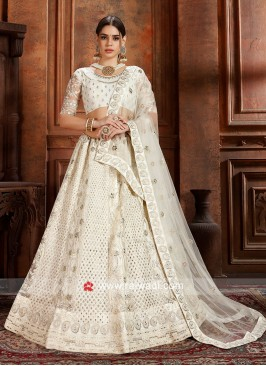 Soft Net White Lehenga Choli with Dupatta.