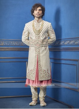 Stylish cream and peach groom sherwani
