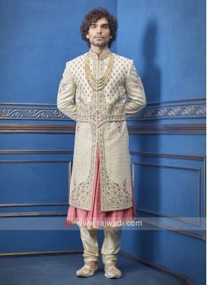 Stylish cream and peach groom sherwani