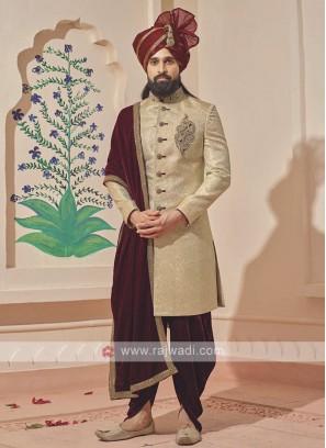 Stylish golden and maroon sherwani