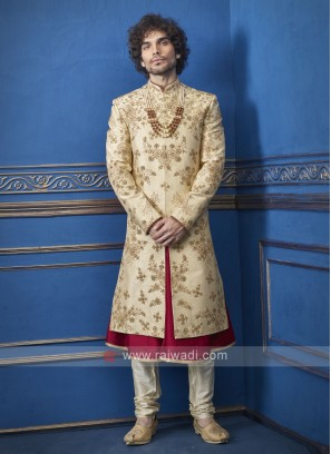 Stylish golden and red groom sherwani