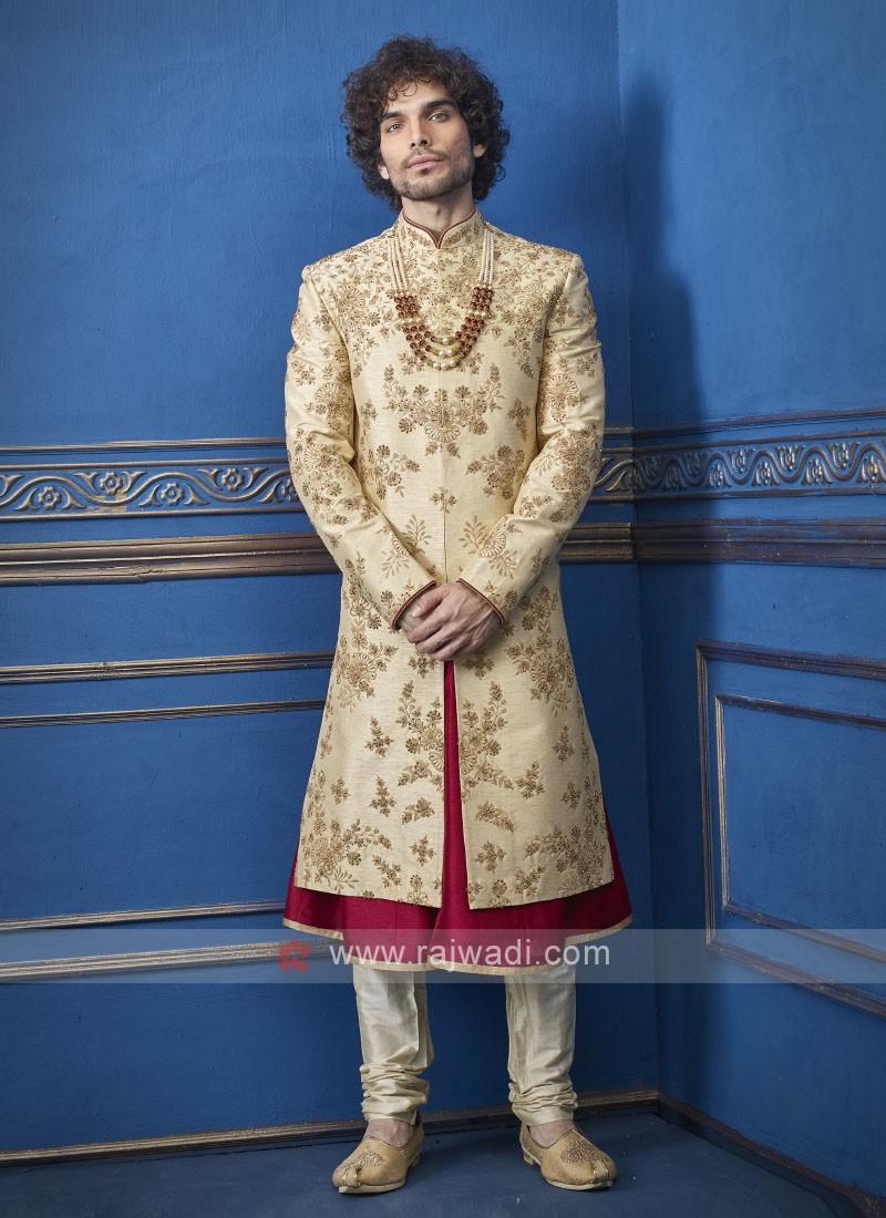 Stylish golden and red groom sherwani